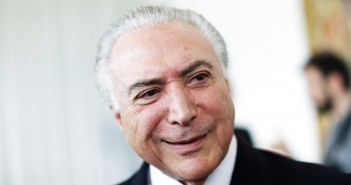 Brazil's President Michel Temer reacts after a breakfast with foreign media at Alvorada Palace in Brasilia